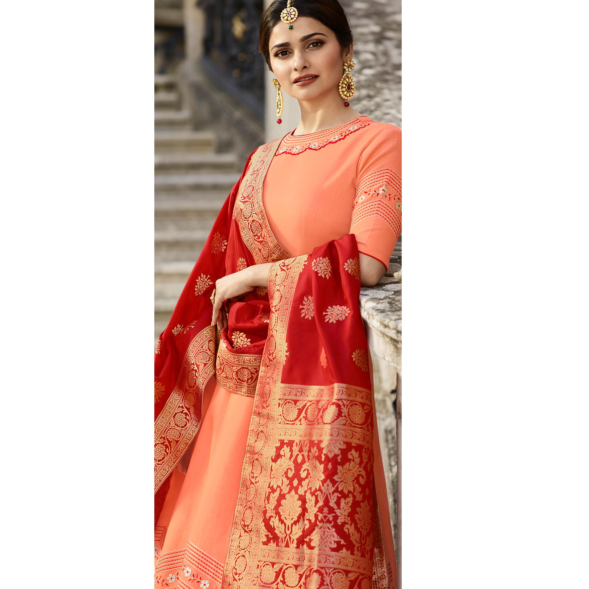 Glowing Peach Colored Partywear Embroidered Art Silk Gown With Banarasi Silk Dupatta