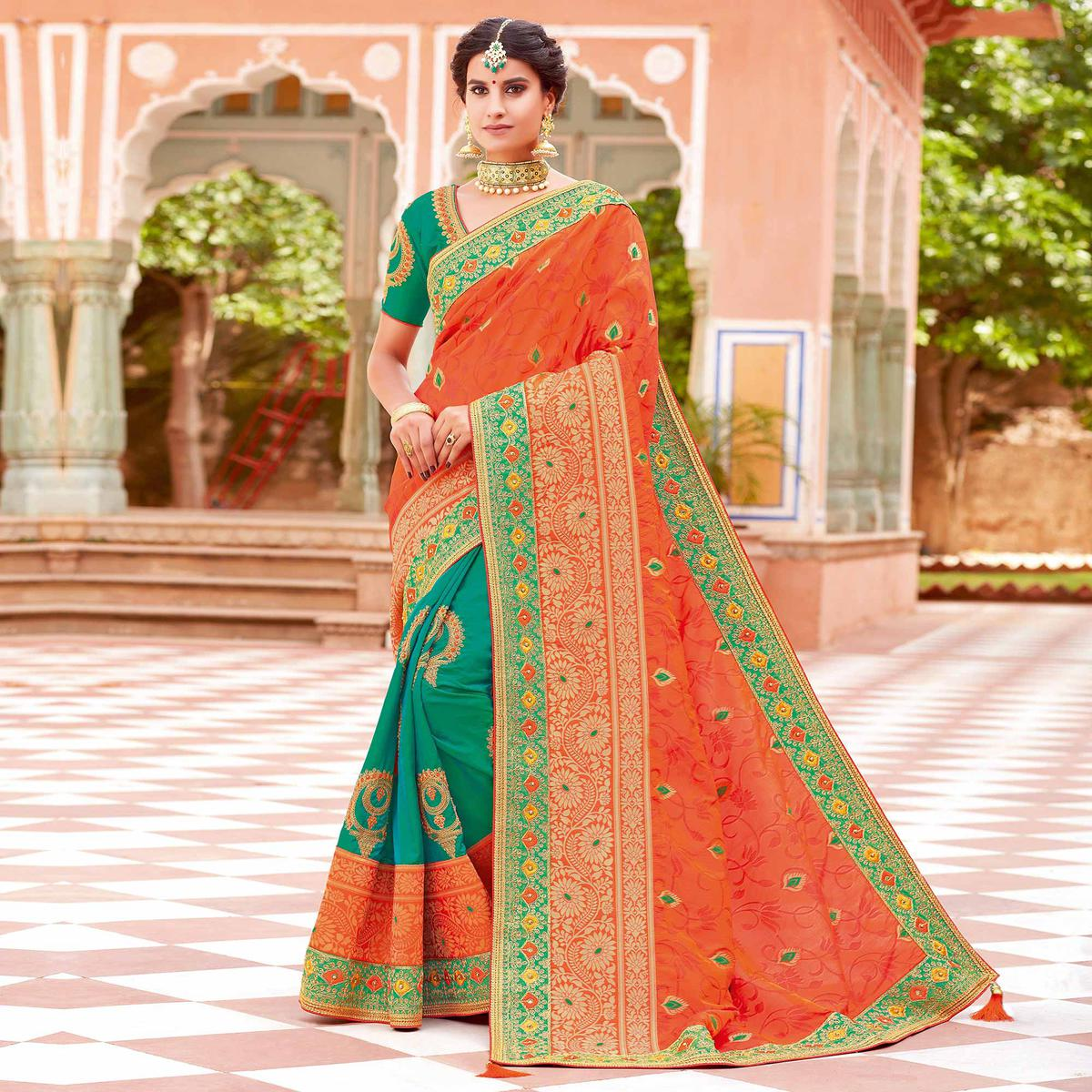 Opulent Orange-Green Colored Partywear Woven-Embroidered Silk Half-Half Saree