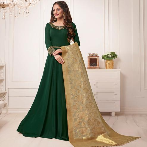 Trendy Dark Green Colored Partywear Embroidered Cotton Silk Anarkali Suit