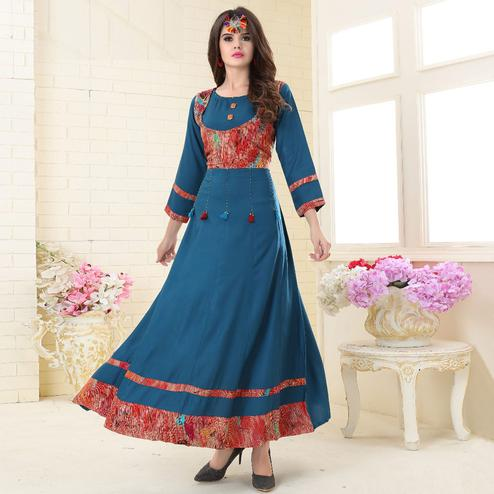Lovely Blue Colored Partywear Embroidered Rayon Kurti