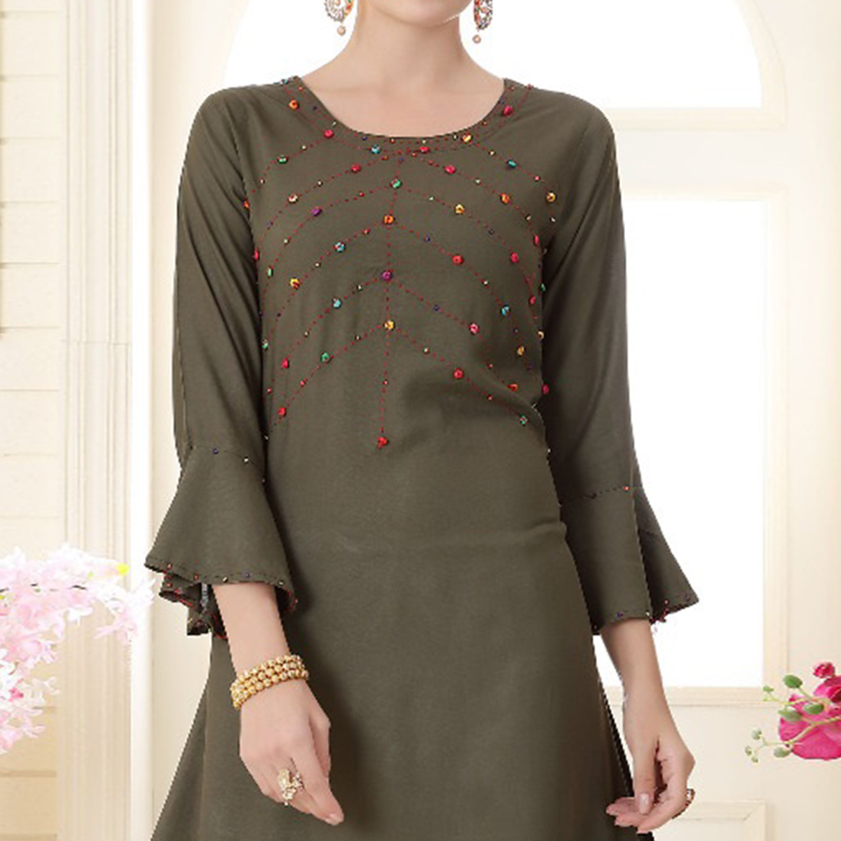 Demanding Dark Olive Green Colored Partywear Embroidered Rayon Kurti