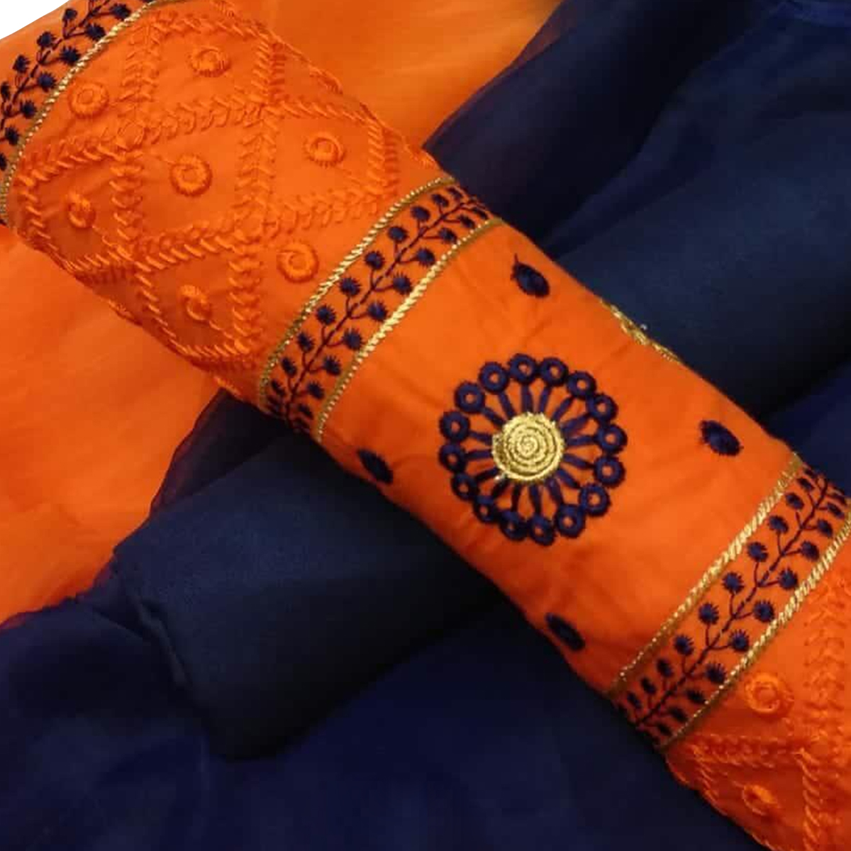 Eye-Catching Orange Colored Partywear Embroidered Cotton Dress Material