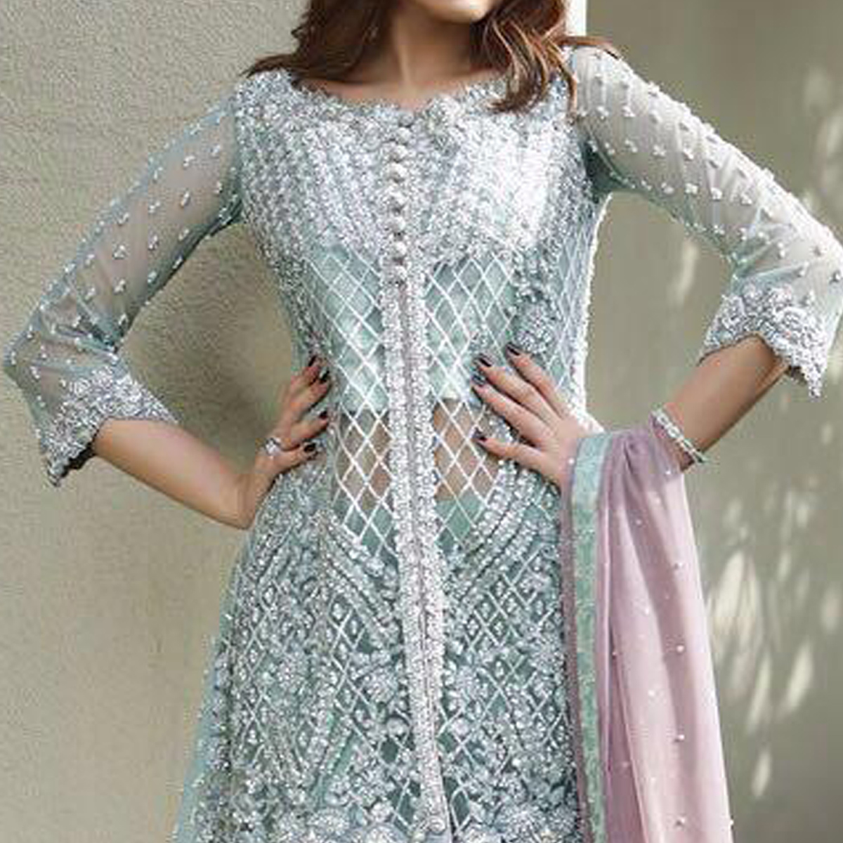 Refreshing Aqua Blue Colored Partywear Embroidered Netted Palazzo Suit