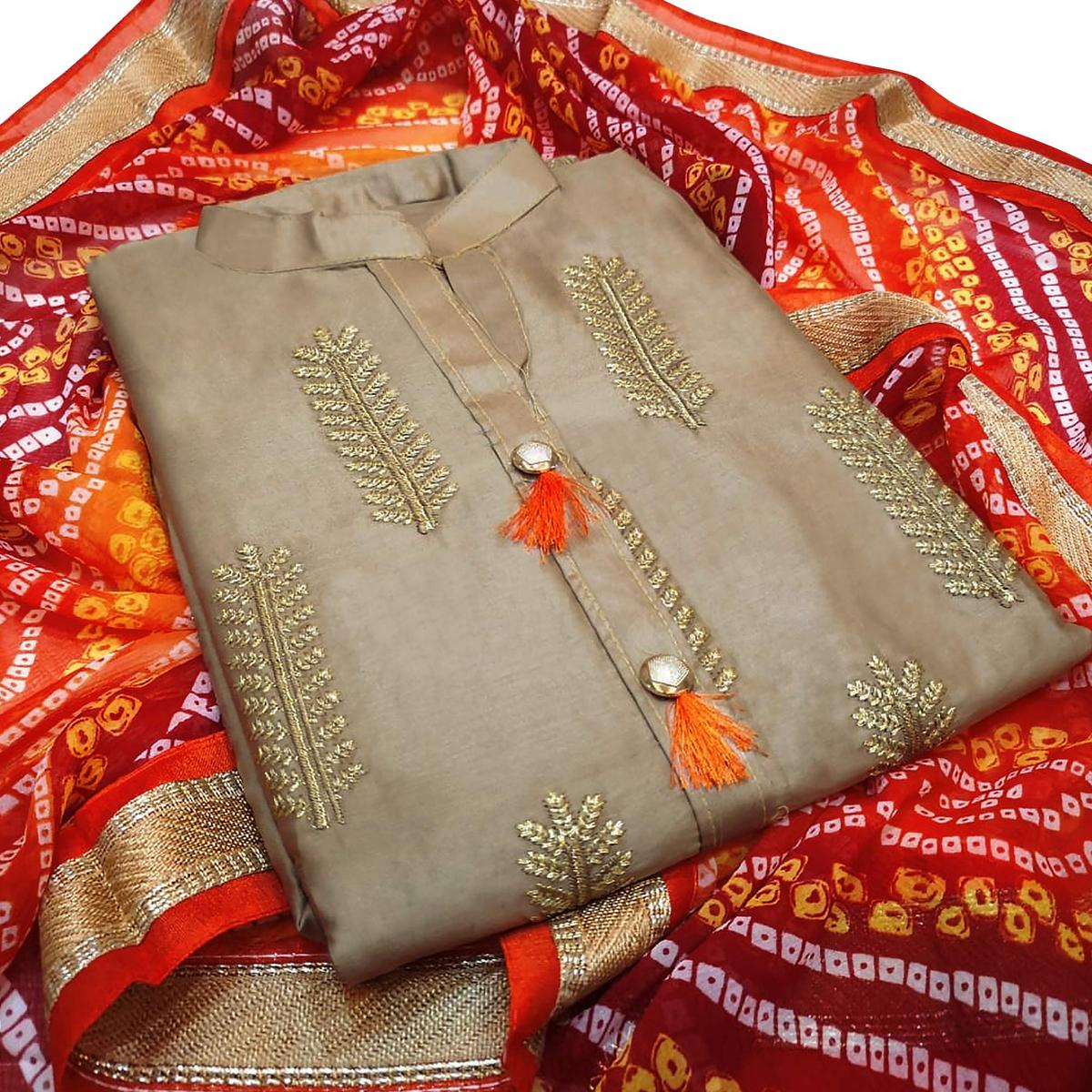 Gorgeous Beige Colored Partywear Embroidered Cotton Dress Material