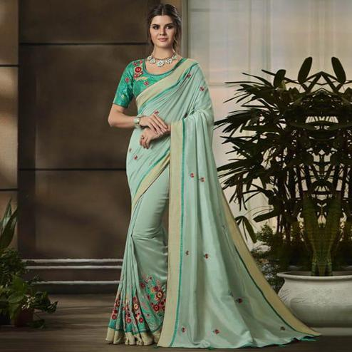 Fantastic Light Aqua Blue Colored Partywear Embroidered Art Silk Saree