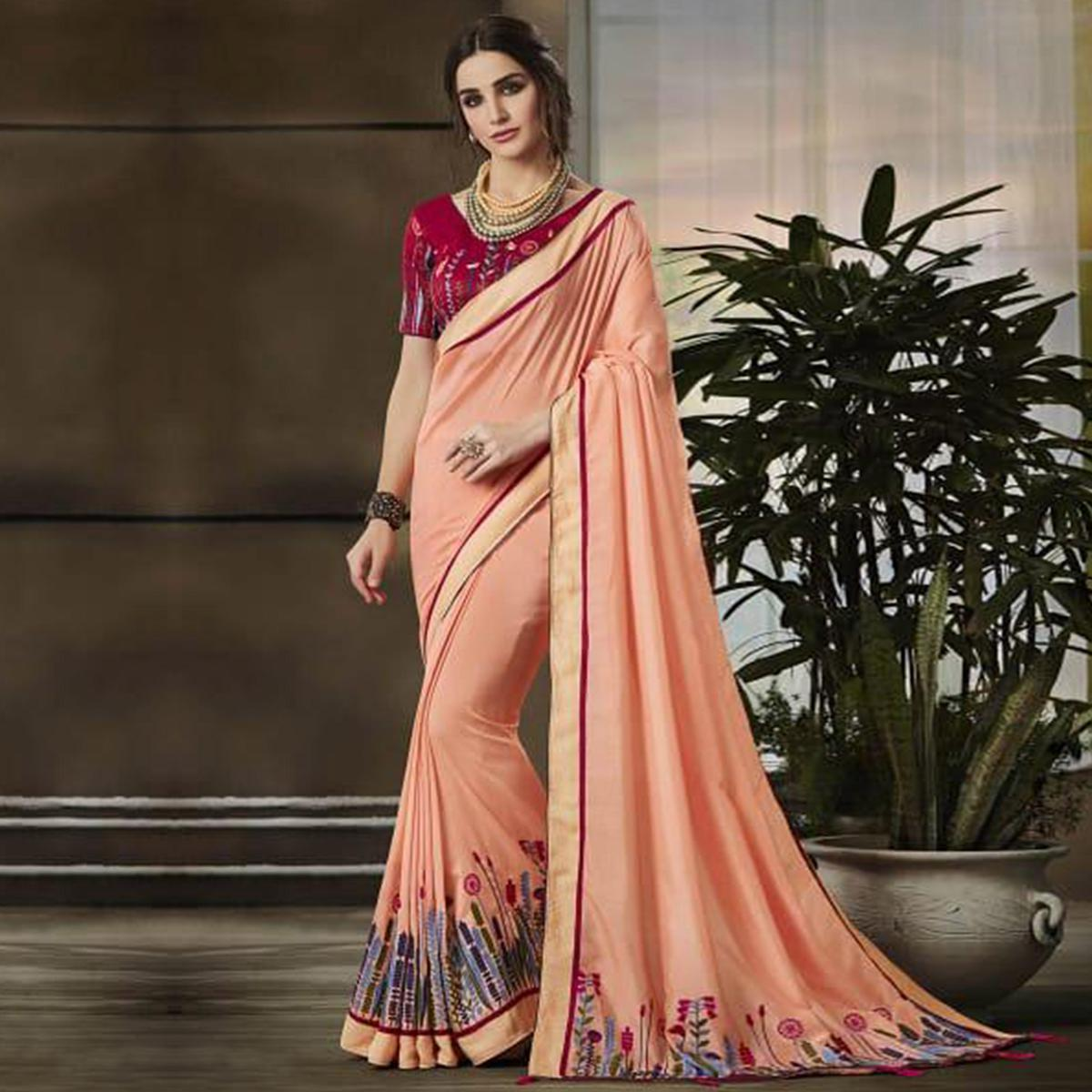 Stunning Peach Colored Partywear Embroidered Art Silk Saree