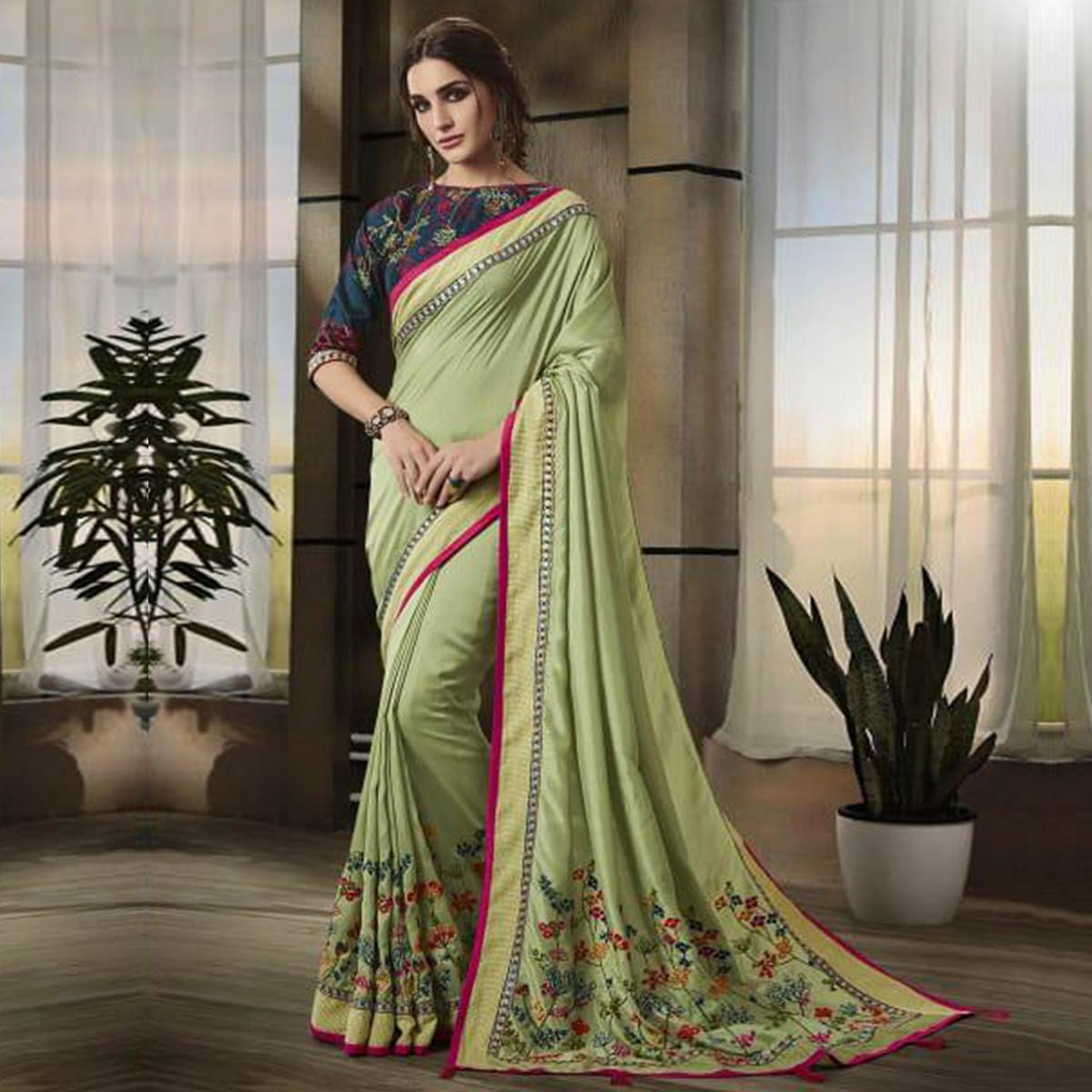 Attractive Pista Green Colored Partywear Embroidered Art Silk Saree Intricate Gray Colored Partywear