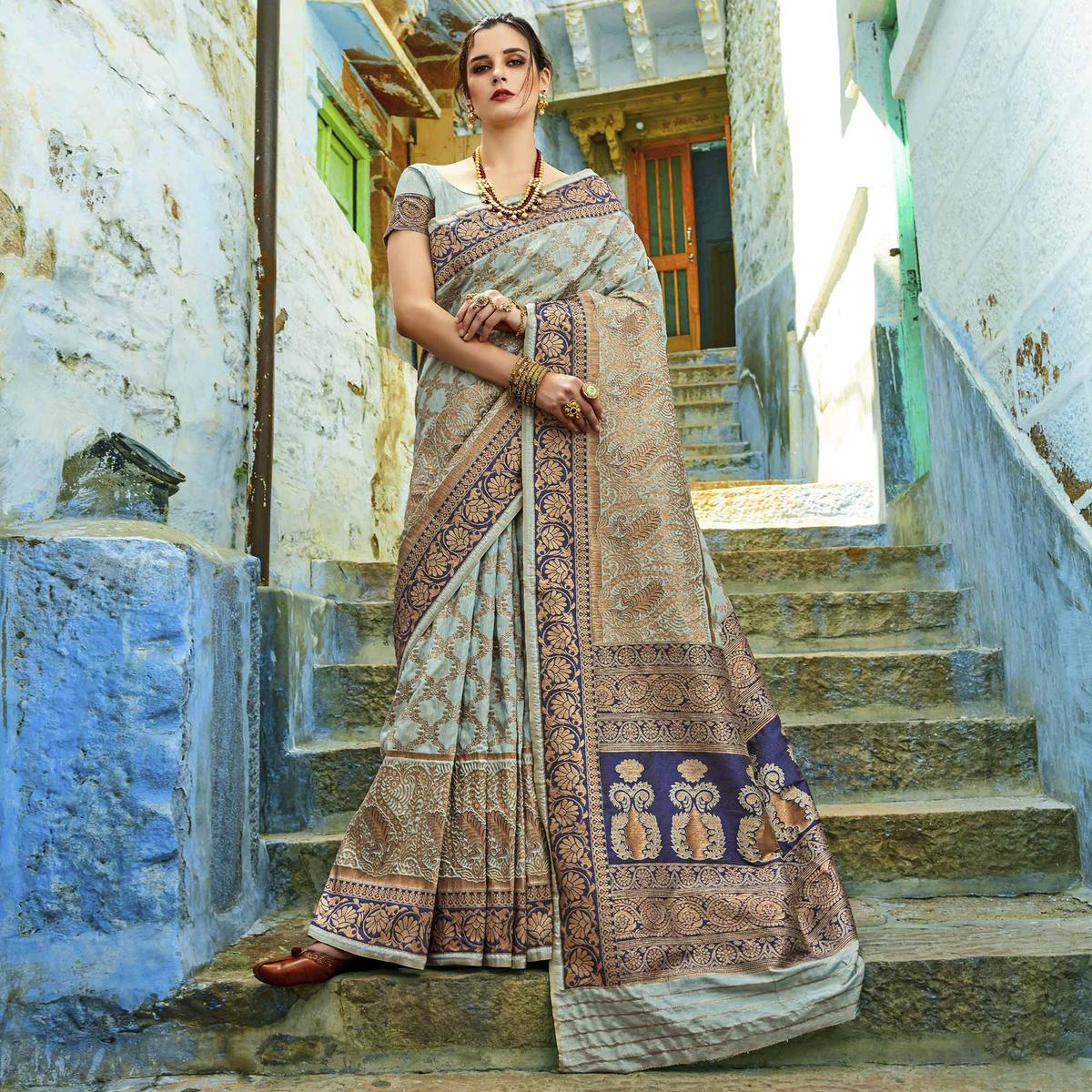 Surpassing Light Blue Colored Festive Wear Woven Silk Saree