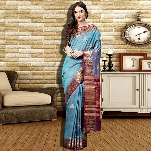 Stunning Light Blue Colored Festive Wear Woven Silk Saree