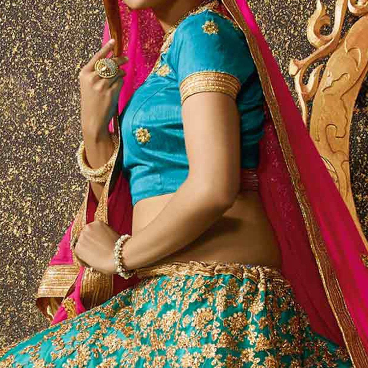 Attractive Firozi Colored Party Wear Embroidered Net Lehenga Choli
