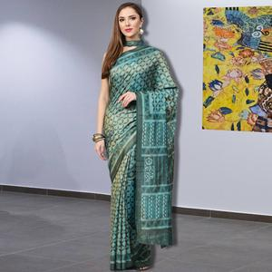 Staring Turquoise Blue Colored Casual Printed Silk Saree