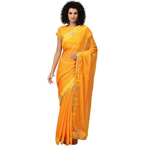 Breathtaking Orange Colored Party Wear Georgette Saree
