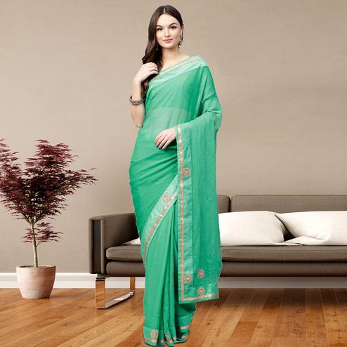 Exceptional Turquoise Green Colored Party Wear Georgette Saree