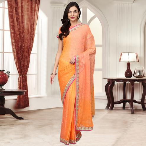 Arresting Orange - Peach Colored Party Wear Embroidered Chiffon Saree