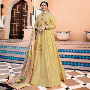 Glowing Yellow Colored Partywear Embroidered Art Silk Anarkali Suit