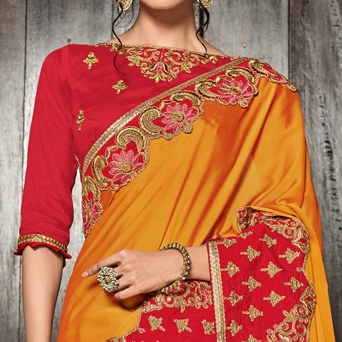 Desirable Orange Colored Partywear Embroidered Georgette Saree