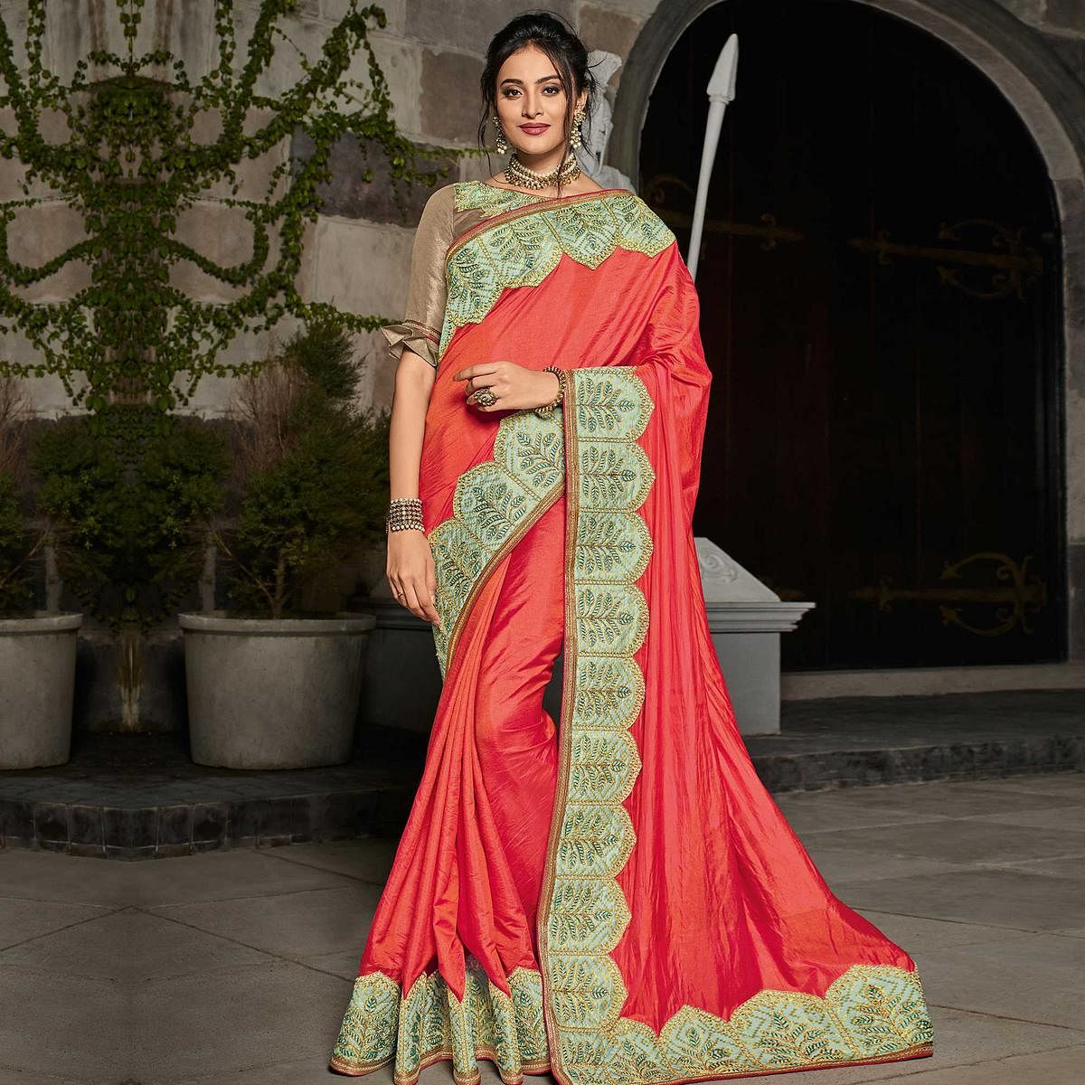 Elegant Orange Colored Partywear Embroidered Silk Saree