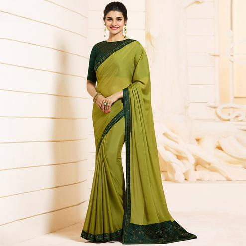 Exceptional Pine Green Colored Partywear Embroidered Georgette Saree