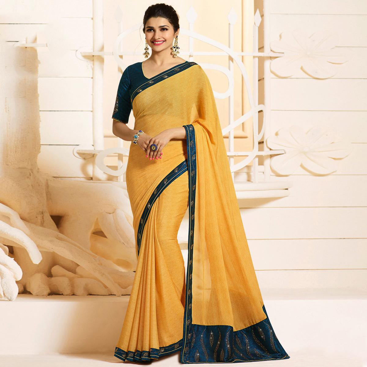 Impressive Yellow Colored Partywear Embroidered Georgette Saree