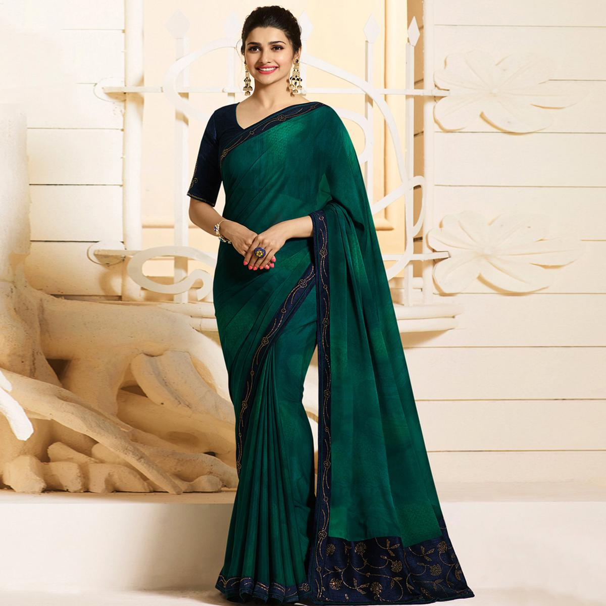Marvellous Peacock Green Colored Partywear Embroidered Georgette Saree