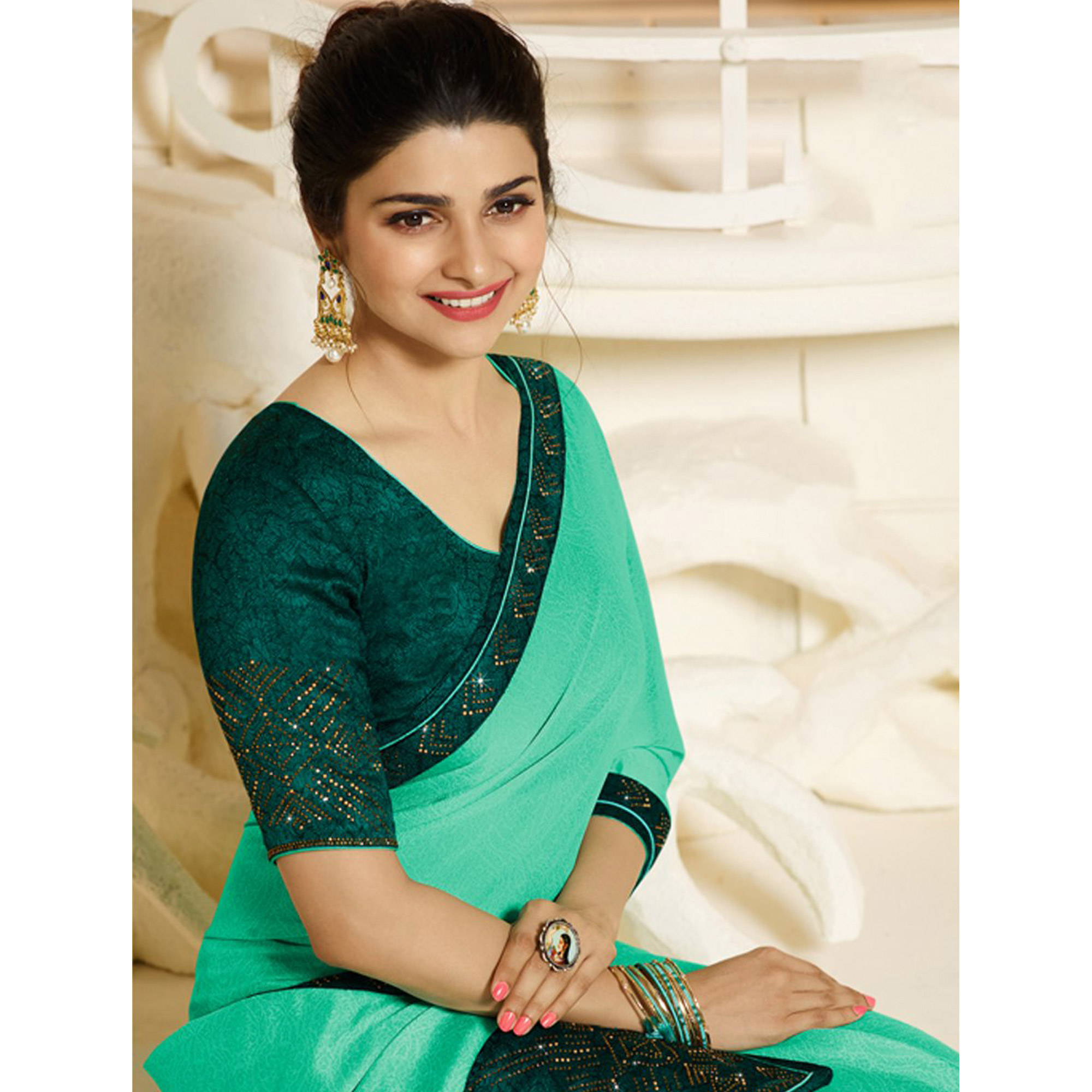 Gorgeous Turquoise Green Colored Partywear Embroidered Georgette Saree