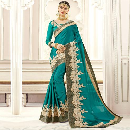Delightful Teal Blue Colored Party Wear Embroidered Georgette Saree