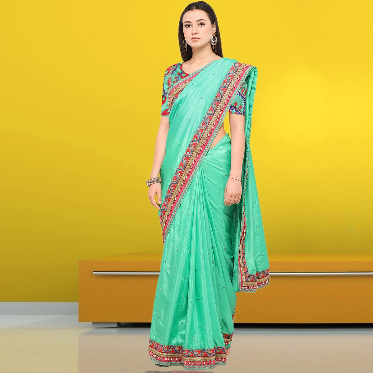 Blissful Aqua Green Colored Party Wear Embroidered Raw Silk Saree