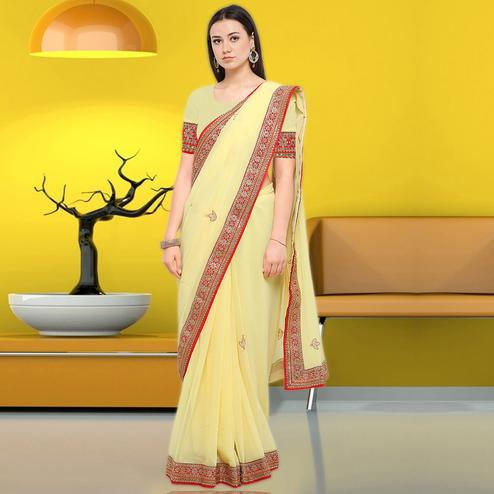 Engrossing Yellow Colored Party Wear Embroidered Chiffon Saree