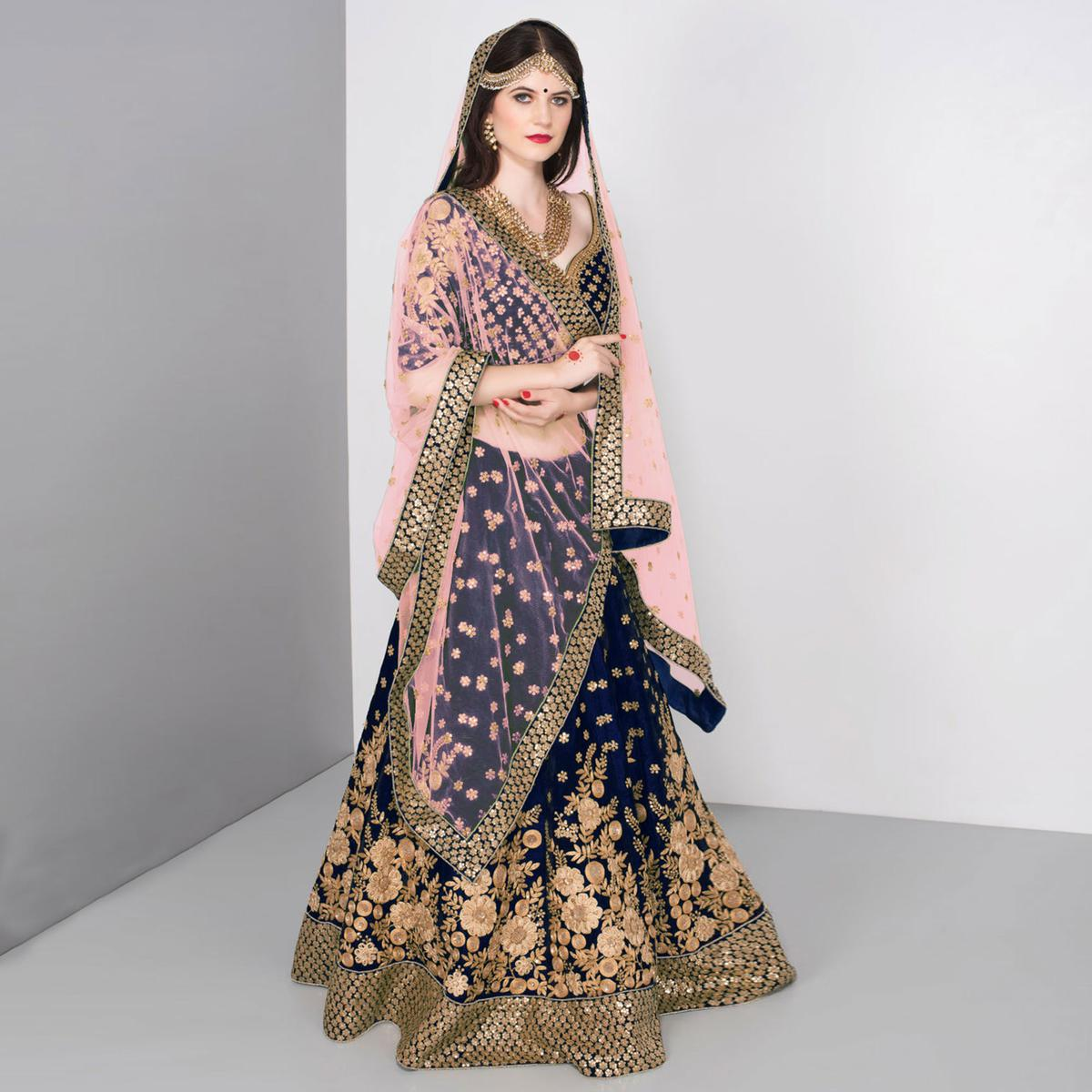 Stunning Blue Colored Partywear Embroidered Pure Velvet Lehenga Choli