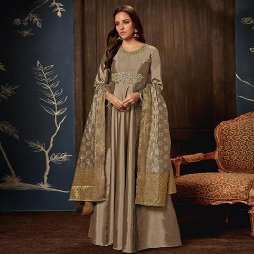 Appealing Beige Colored Partywear Embroidered Tapeta Silk Gown