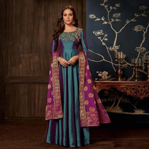 Flamboyant Teal Blue Colored Partywear Embroidered Tapeta Silk Gown