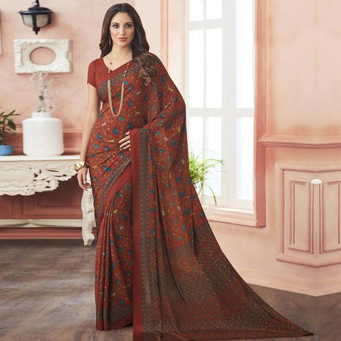 Elegant Rust Orange Colored Casual Printed Pure Crepe Saree