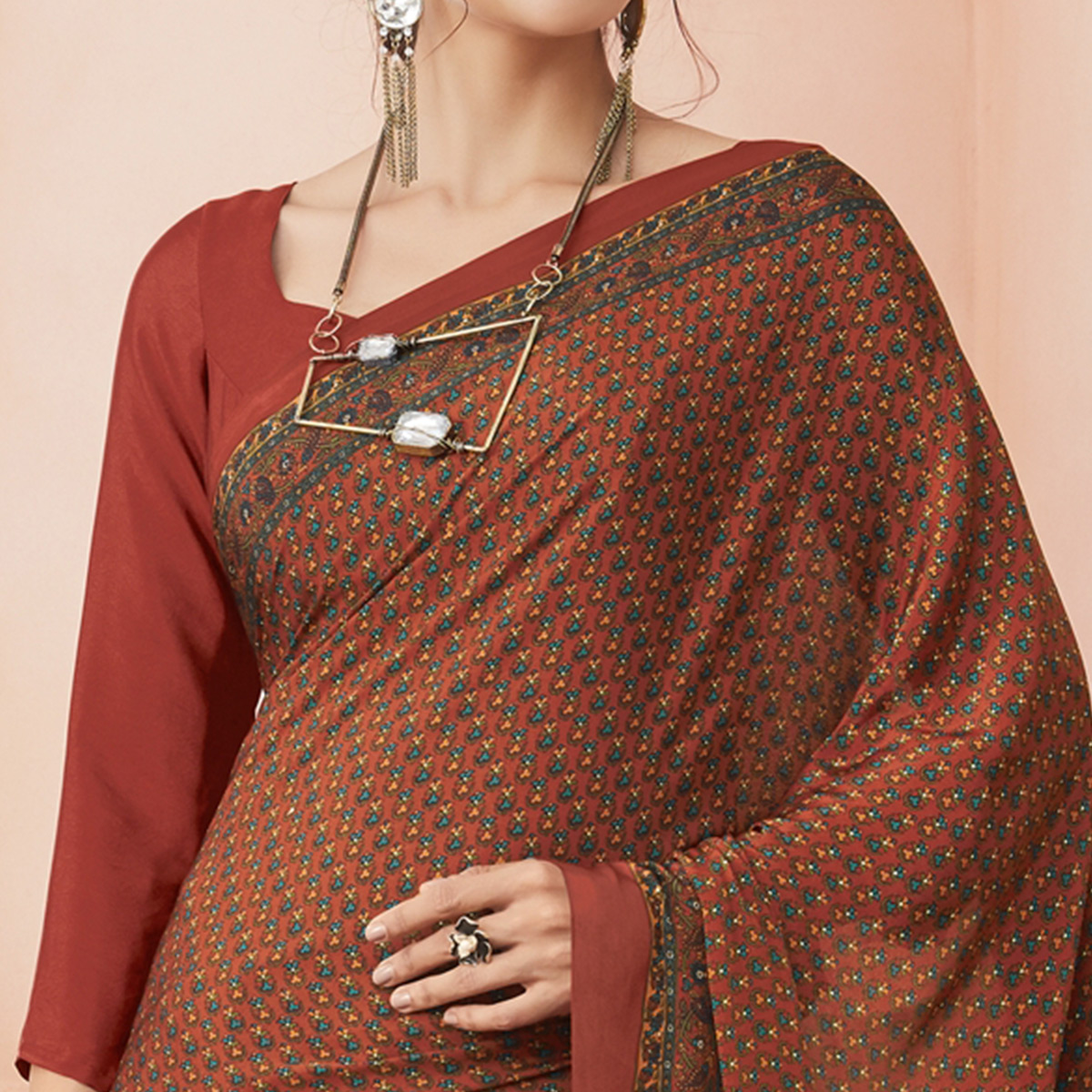 Demanding Rust Orange Colored Casual Printed Pure Crepe Saree
