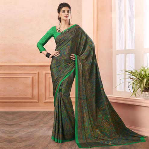 Intricate Green Colored Casual Printed Pure Crepe Saree