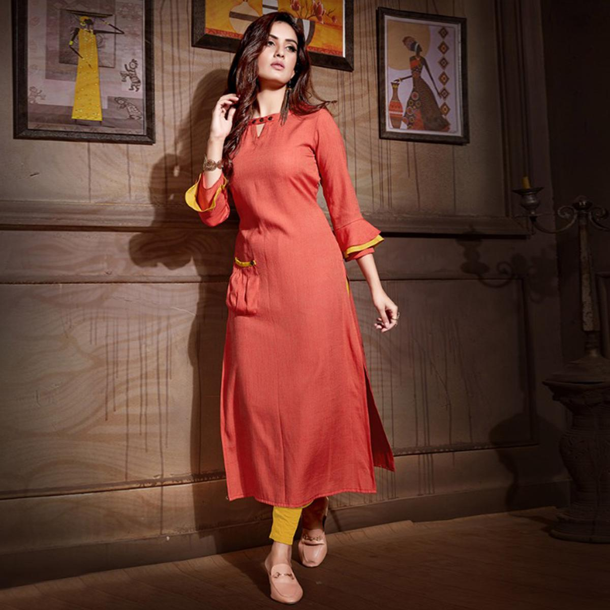 Beautiful Coral Red Colored Partywear Heavy Rayon Fancy Kurti