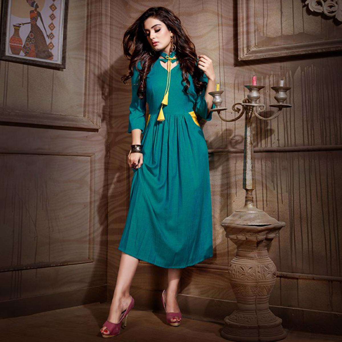 Trendy Blue Colored Partywear Heavy Rayon Fancy Kurti