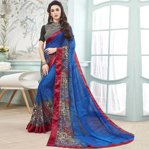 Surpassing Blue Colored Casual Wear Printed Georgette Saree