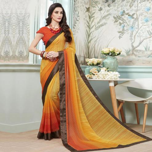 Ideal Yellow - Orange Colored Casual Wear Printed Georgette Saree