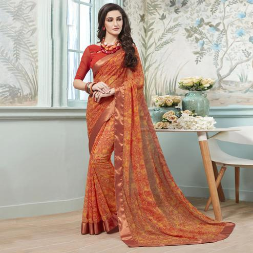 Pleasance Orange Colored Casual Wear Printed Georgette Saree