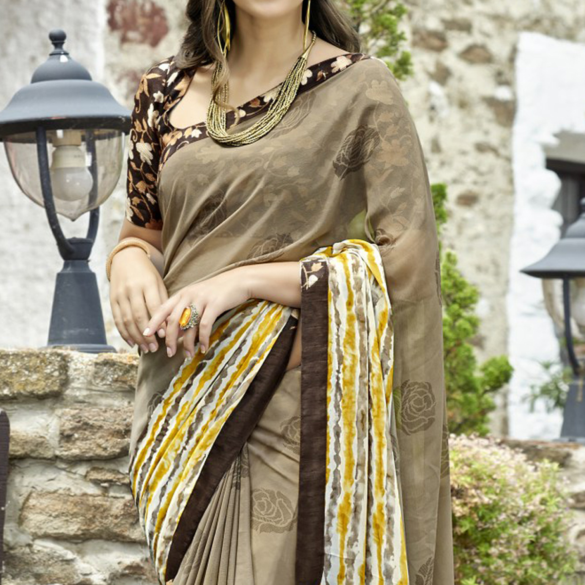 Radiant Light Brown Colored Casual Printed Faux Georgette Saree