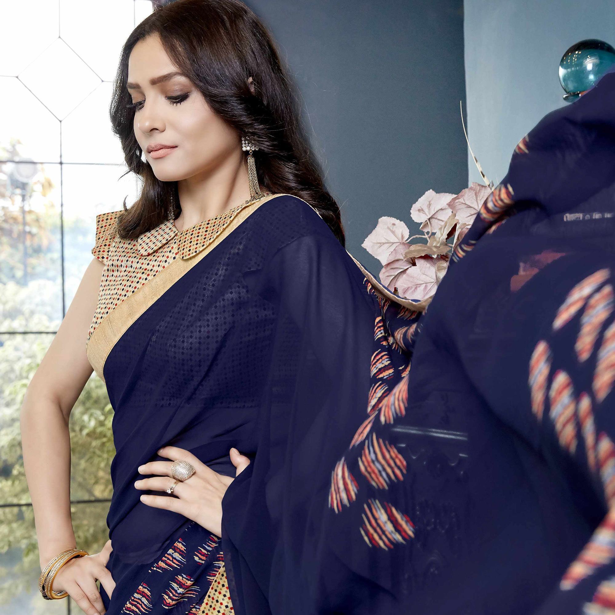 Glowing Navy Blue Colored Casual Printed Faux Georgette Saree