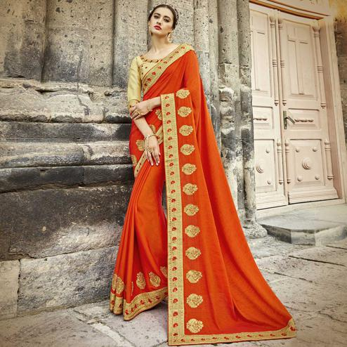 Marvellous Orange Colored Partywear Embroidered Silk Saree