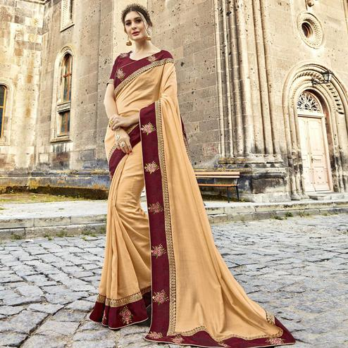 Engrossing Cream Colored Partywear Embroidered Silk Saree