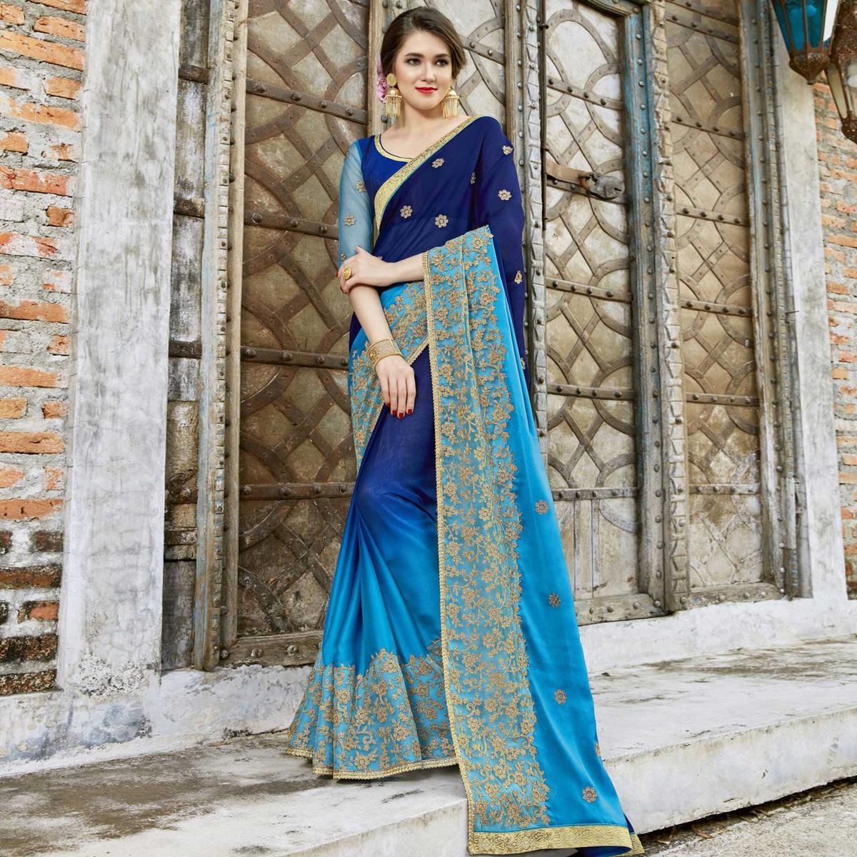Magnetic Blue Colored Partywear Embroidered Pure Georgette Saree