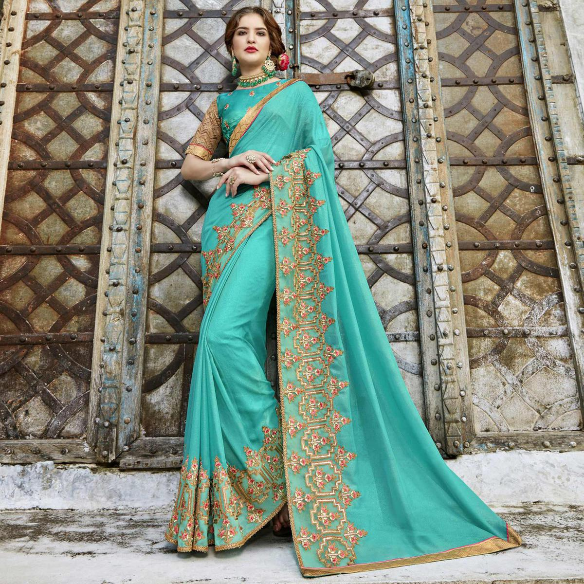 Stunning Aqua Blue Colored Partywear Embroidered Pure Georgette Saree