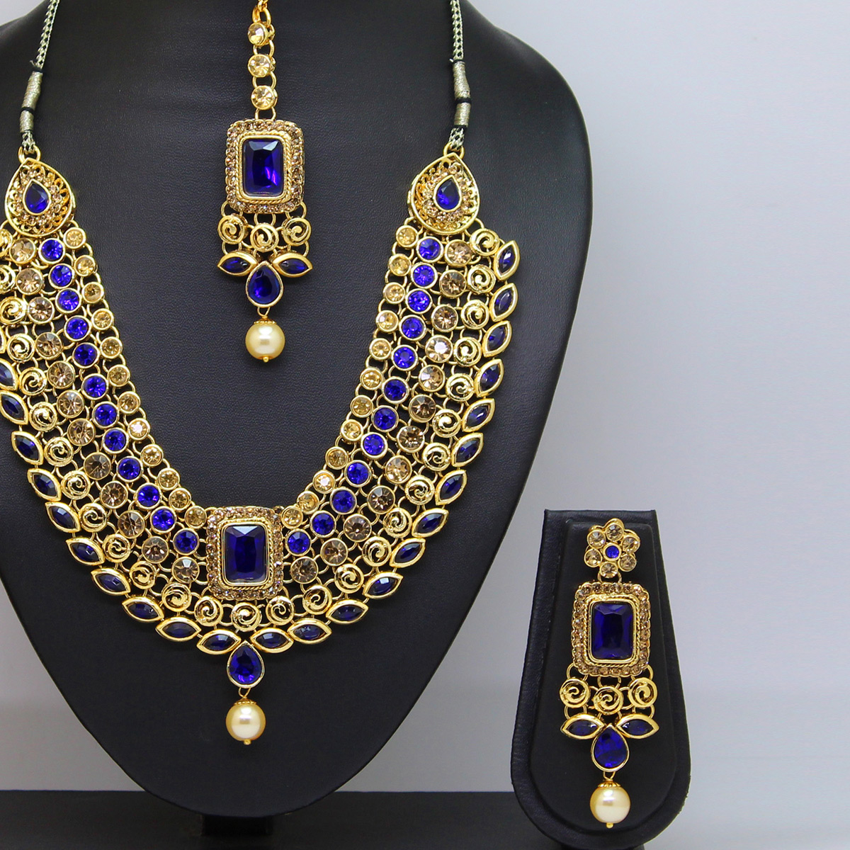 Alluring Royal Blue Colored Kundan Work Stone & Pearl Necklace Set