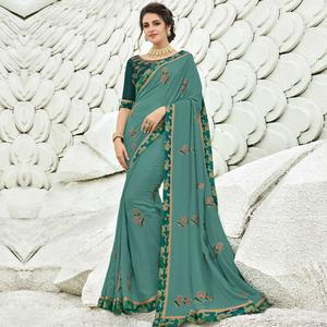 Mesmerising Green Colored Partywear Embroidered Silk Saree