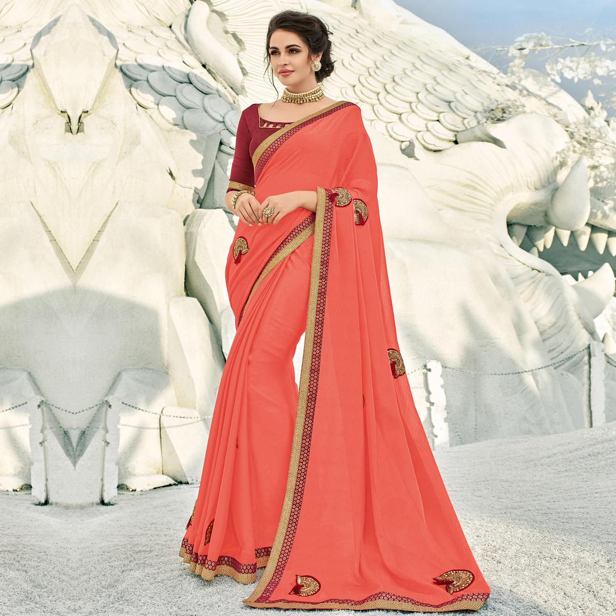Lovely Peach Colored Partywear Embroidered Silk Saree