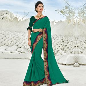 Glorious Turquoise Green Colored Partywear Embroidered Georgette Saree