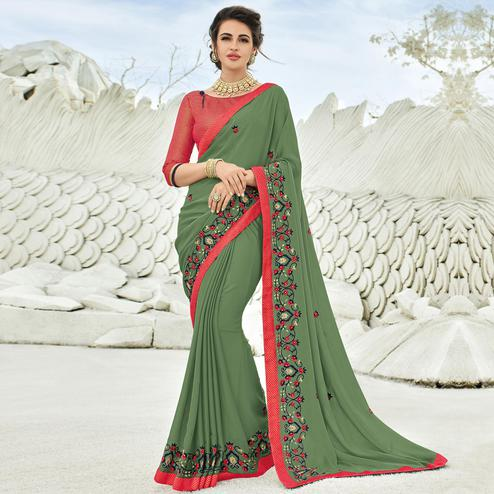 Beautiful Olive Green Colored Partywear Embroidered Georgette Saree